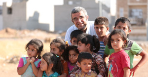 Ehab el-Kharrat visiting refugee children in Erbil, Iraq (credit: SAT-7)